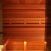Sauna in Highlands Ranch, CO:<br /> *Western Red Cedar paneling horizontally<br /> *Ceiling paneling extends continuously over the adjacent shower<br /> *Standard benches<br /> *Standard backrests<br /> *Custom heaterguard/Footrest<br /> *Custom wall sconce<br /> *Ropelighting under upper bench