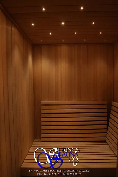 Sauna on Manhattan in New York City:<br /> *Hemlock paneling vertically<br /> *Standard benches<br /> *Custom slanted backrests<br /> *Fiber optic spot lighting