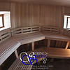 Sauna in New Preston, CT:<br /> *Fully round room; Hemlock paneling vertically<br /> *Standard benches in 3 sections<br /> *3 windows<br /> *Standard backrests<br /> *Step lights & Custom wall sconces