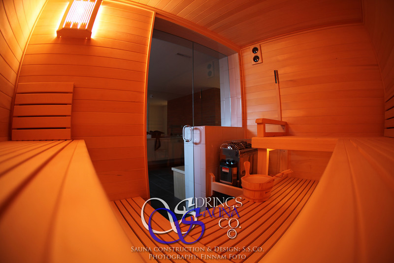 Sauna in Colorado Springs, CO:<br /> *Alaska Yellow Cedar paneling<br /> *Custom bench layout on 2 levels and at custom depths<br /> *Topclass KV heater<br /> *Ropelight under upper bench<br /> *Custom wall fixture with a European light valance in front of it