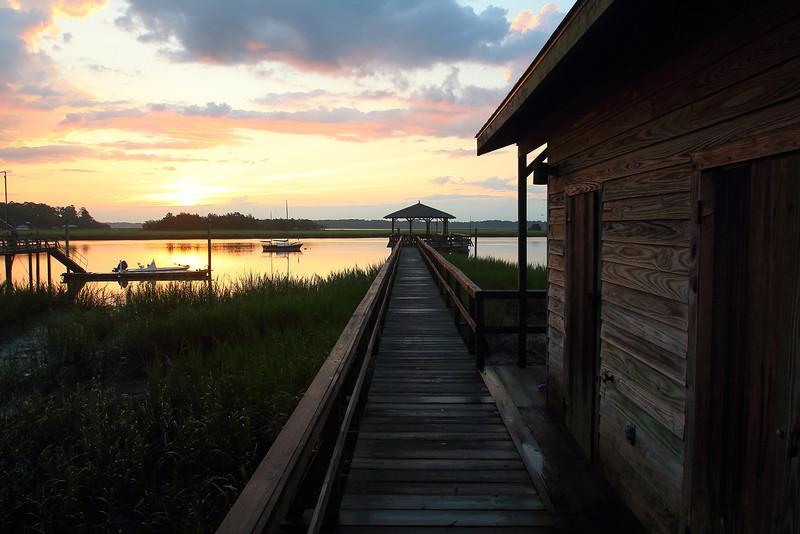 Walkway over the marsh to sunrise.