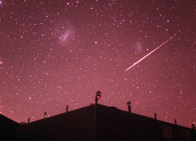 Joseph Brimacombe  A Meteor and the Magellanic Clouds - Aug 24, 2017   Taken from Savannah Skies Observatory using a modified Canon 5D and 24-mm lens.