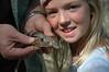 Herpetologist's daughter with alligator lizards.