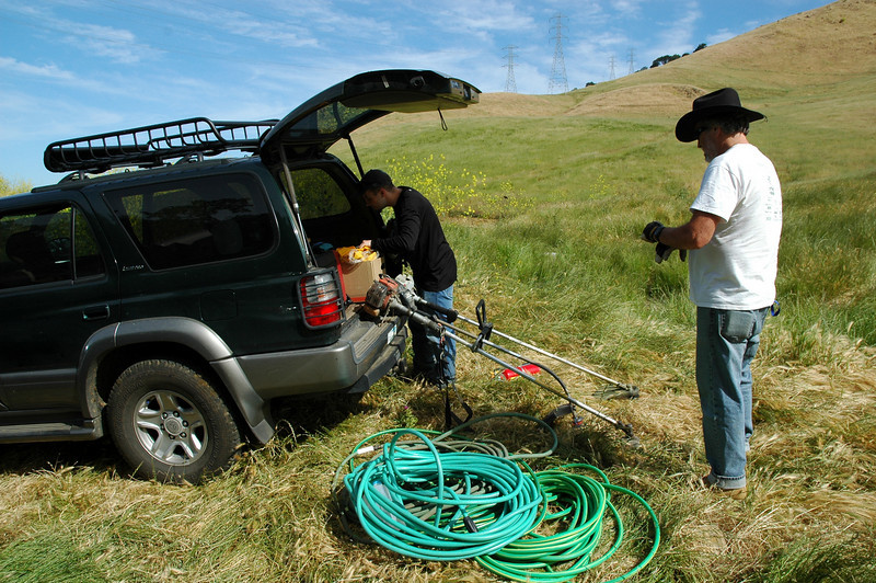 Plenty of hose and weedwhackers are tools of the day.
