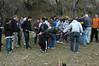 Volunteers grab tools and form planting teams.