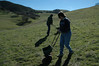 Kristen and Bob use seed spreaders on cattle-frequented hillside near pond gate.