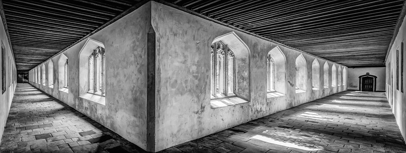 The light streams through the windows on the northern end of the Magdelen College cloisters. The corridors are quiet as the College isn't fully back in business yet after the Summer break.  Tricky shot this - no wide-angle lens so two shots (left and right corridors separately shot as HDR) blended in Photoshop. Plus a variety of maintenance works cropped out of one of the corridors! B&W version.