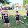 AIMEE AMBROSE | THE GOSHEN NEWS <br /> Members of Team Battle Ready strike a pose while preparing to perform a tumbling and stunting routine during the senior talent show in Heritage Park at the Elkhart County Fair Wednesday.