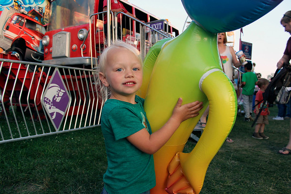 CAMDEN CHAFFEE | THE GOSHEN NEWS<br /> Lucy Herrli stands with her large inflatable alien Wednesday at the Elkhart County 4-H Fair.