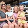 BEN MIKESELL | THE GOSHEN NEWS<br /> Brook Schmiesing, of Portland, Ind., with, from left, Claire Schmiesing, 6, Brenna Schmiesing, 10, and Emily Geesaman, 4.