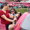 BEN MIKESELL | THE GOSHEN NEWS<br /> Carrie Norris, left, of Goshen, rides the elephant ride with Mim Norris, 5, during the disability day Monday at the Elkhart County 4-H Fairgrounds.