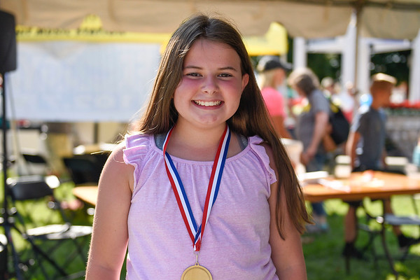 BEN MIKESELL | THE GOSHEN NEWS<br /> Ellie Schupert, 10, of Bristol, winner of her division in the frog jump Wednesday morning.
