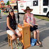 Roger Schneider | The Goshen News<br /> Karen Gill, left, and Sherri Grindle, Fairfield marching band parents, volunteered to take tickets Friday at the Elkhart County 4-H Fair.