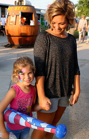 CAMDEN CHAFFEE | THE GOSHEN NEWS<br /> Mother and daughter Lisa and Karis Yoder walk around Wednesday enjoying the Elkhart County 4-H Fair.