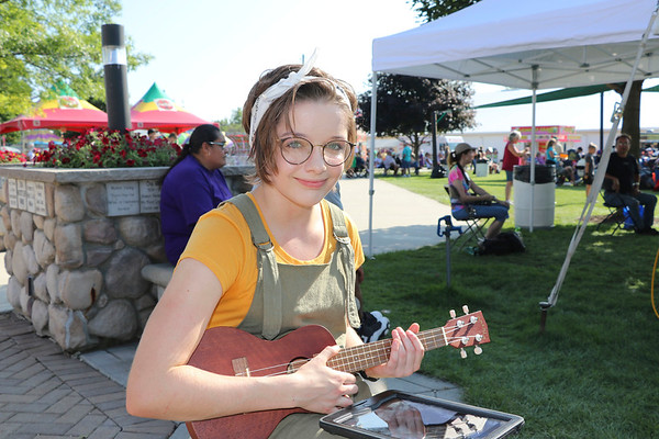 AIMEE AMBROSE | THE GOSHEN NEWS <br /> Chynzie Howell, 14, Goshen, prepares to perform an original song on a ukulele for the senior talent show in Heritage Park at the Elkhart County Fair Wednesday.