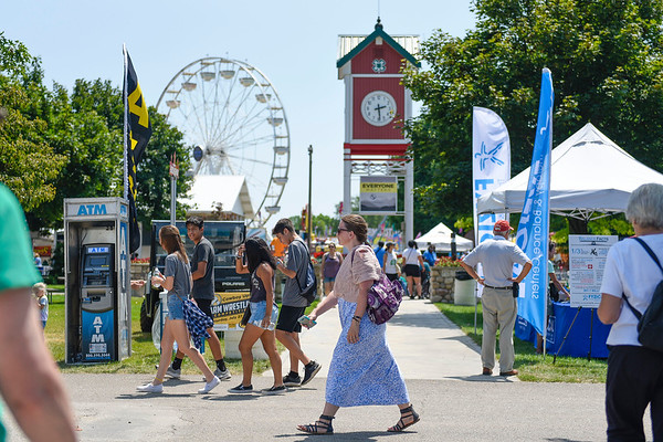 BEN MIKESELL | THE GOSHEN NEWS<br /> Fairgoers walk through Heritage Park Tuesday.
