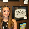 AIMEE AMBROSE | THE GOSHEN NEWS <br /> Katelyn Brown, 15, Goshen, stands next to her framed pencil drawing of a bird in the 4-H exhibit hall at the Elkhart County Fair.