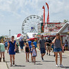 BEN MIKESELL | THE GOSHEN NEWS<br /> Fairgoers walk down food row July 20 at the Elkhart County 4-H Fairgrounds.