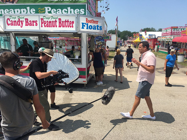 "BEN MIKESELL | THE GOSHEN NEWS<br /> Noah Cappe, right, from Food Network's Cooking Channel show ""Carnival Eats"" is at the Elkhart County 4-H Fair this week."