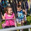 BEN MIKESELL | THE GOSHEN NEWS<br /> Addison Johnson, 4, of Elkhart, rides during kid's day Wednesday morning.