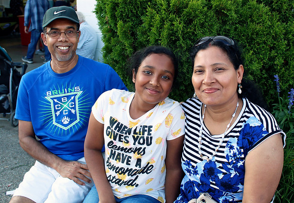 CAMDEN CHAFFEE | THE GOSHEN NEWS<br /> Ranendra, Neer and Neela Goswami sit down for a short break Wednesday while having a good time at the Elkhart County 4-H Fair.