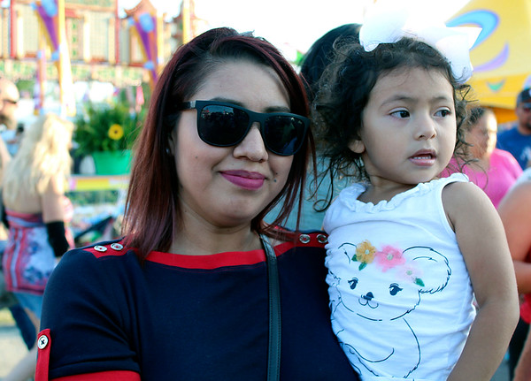 CAMDEN CHAFFEE | THE GOSHEN NEWS<br /> Mother and daughter Erika and Kayla Salgado stand in line for rides Wednesday at the Elkhart County 4-H Fair.