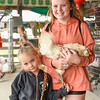 BEN MIKESELL | THE GOSHEN NEWS<br /> Riley Dodson, 11, of Nappanee, right, with Bailey Dodson, 5, at the 4-H Poultry Club.