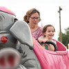 BEN MIKESELL | THE GOSHEN NEWS<br /> Carissa Mullen, 4, of Goshen, rides the elephant ride with her mother Linda during disability day Monday at the Elkhart County 4-H Fairgrounds.