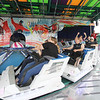 "AIMEE AMBROSE | THE GOSHEN NEWS <br /> Riders take a spin on the ""Himalaya"" at the Elkhart County Fair midway. Several rides were toned down with slower speeds, dimmed lights and quieter music to accommodate fairgoers with intellectual or developmental disabilities Monday as part of the fair's Disabilities Awareness Day."