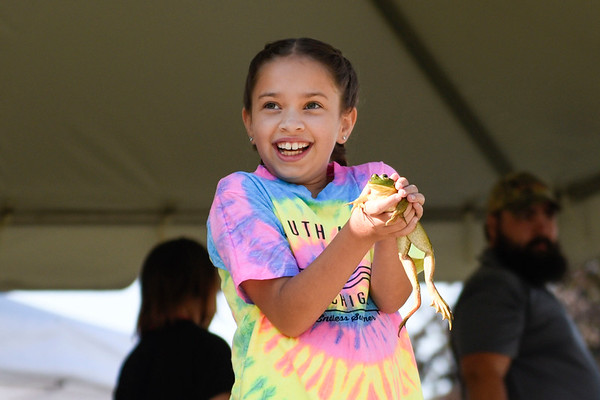 BEN MIKESELL | THE GOSHEN NEWS<br /> Juliet Hochstetler, 10, of Goshen, holds a frog before she competes in the frog jump Wednesday morning.