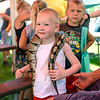 BEN MIKESELL | THE GOSHEN NEWS<br /> Hunter Seaver, 3, of Middlebury, holds a ball python during kid's day Wednesday afternoon at the Elkhart County 4-H Fair.