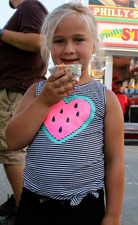 CAMDEN CHAFFEE | THE GOSHEN NEWS<br /> Sage Kwilinski enjoys her Dippin' Dots Wednesday at the Elkhart County 4-H Fair.