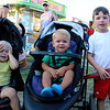 CAMDEN CHAFFEE | THE GOSHEN NEWS<br /> Playmates Carter Farmer and Riley and Parker Williams hang out by the carnival games Wednesday at the Elkhart County 4-H Fair.