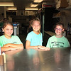 Roger Schneider | The Goshen News<br /> Helping customers at the Rabbit Club food stand Friday were, from left, Aubrey Kelly, 10, Lilly Bieganski, 11, and Kieren Adair, 9, all of Goshen.