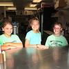 Roger Schneider | The Goshen News<br /> Helping customers at the Rabbit Club food stand Friday were, from left, Aubrey Kelly, 10, Lilly Bieganski, 11, and Kieren Adair, 9, all of Goshen.