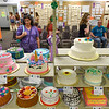 BEN MIKESELL | THE GOSHEN NEWS<br /> Denise Murphy, of Goshen, looks at award-winning decorated cakes Monday afternoon.
