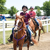 BEN MIKESELL | THE GOSHEN NEWS<br /> Shannon Parcell, 11, front, rides horses with Laynee Peffley, 11, both of Goshen.