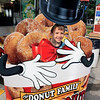 Roger Schneider | The Goshen News<br /> Caleb Smith, 5, of Wakarusa, couldn't resist poking his face through the hole at The Donut Family characture display.