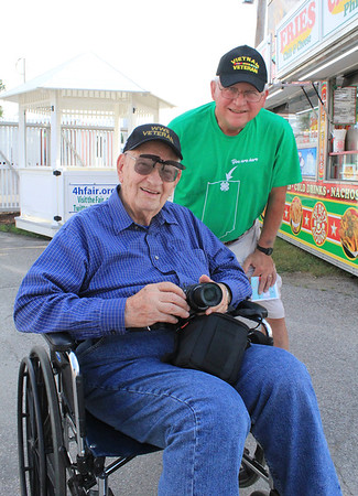 Roger Schneider | The Goshen News<br /> Ed Resler, seated, an Army Air Corps veteran of World War II and Ron Boach, a Vietnam War veteran, arrived early at the fair Friday to take pictures and enjoy Veterans' Day activities.