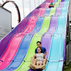 "AIMEE AMBROSE | THE GOSHEN NEWS <br /> Erin Rosenberry of Elkhart and her older brother Evan reach the bottom of the ""Fun Slide"" together at the Elkhart County Fair. Monday was Disabilities Awareness Day, and in honor of it, many rides helped accommodate fairgoers with intellectual or developmental disabilities."