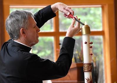 Fr. Jim lights the candel