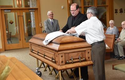 Br. Duane and Br. Frank prepare the casket