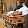 Br. Duane and Br. Frank prepare the casket