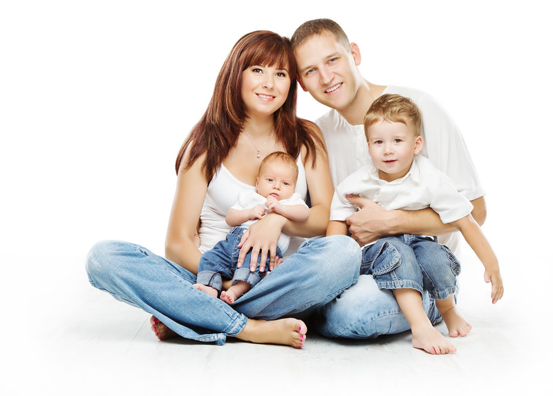 Young family four persons, smiling father mother and two children sons