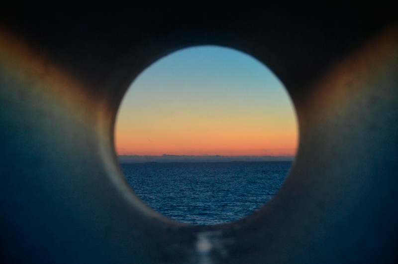 Our last night on the Polarlys -- view from our porthole at 1 am  -- sunset or sunrise?