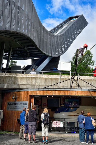 The ski simulator in the foreground provides a five minute ride covering both a jump from the Holmenkollen and a downhill run at 130 kph.  The banking and movement of the simulator is very impressive from the outside.