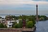 Russia-Saint Petersburg-Kotlin Island-Voennaya Gavan front/Kronstadt Lighthouse rear