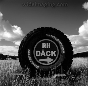 This giant R57 mining tire serves as a billboard in the middle of a field. For the story behind this picture see: http://communityofsweden.com/Pages/Stories/Story.aspx?storyId=2431