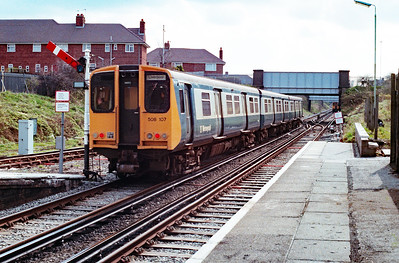 508 107 at Birkenhead North on 7th April 1990