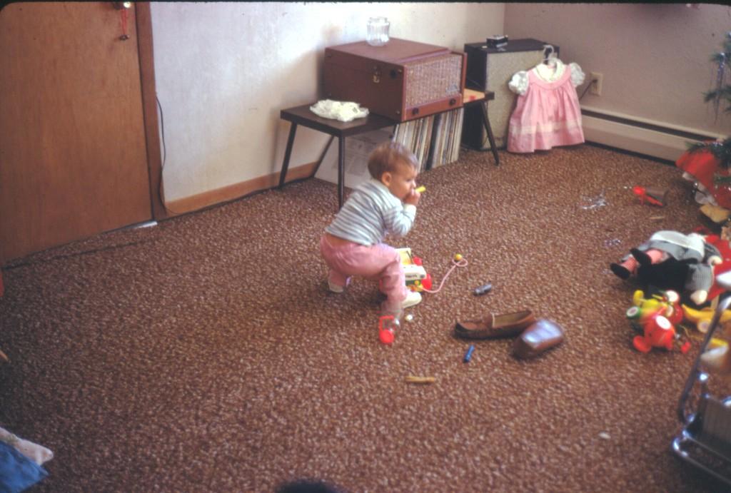 Andi Playing with Christmas Toys